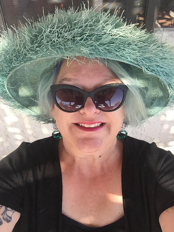 Woman Wearing A Green Hat.