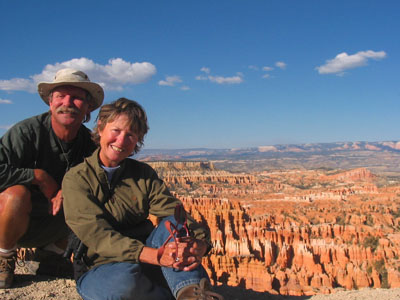 Man And Wife In Front Of The Grand Canyon.