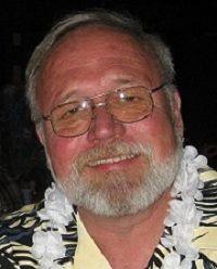 Man Wearing Glasses And A Hawaiian Lei.