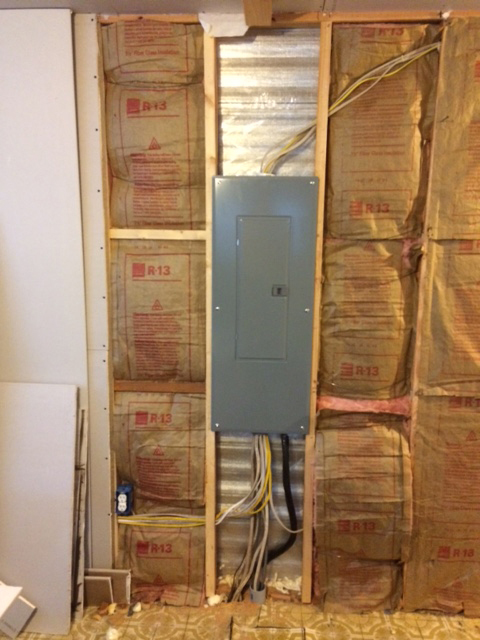 Electrical Panel On A Wall Stripped Down To Studs And Insulation.