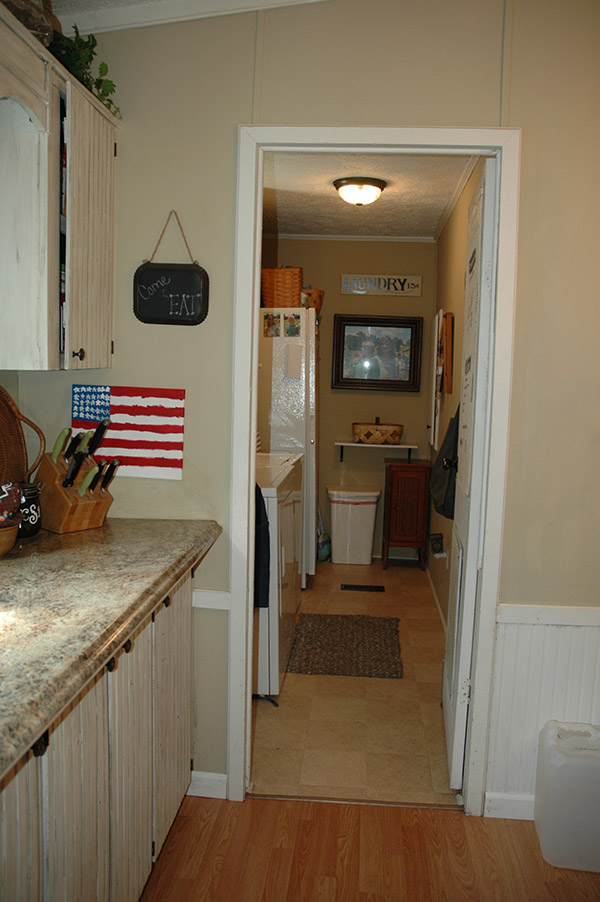 Laundry Room With New Tile Flooring, Painted Walls And Storage In Place Of The Door.