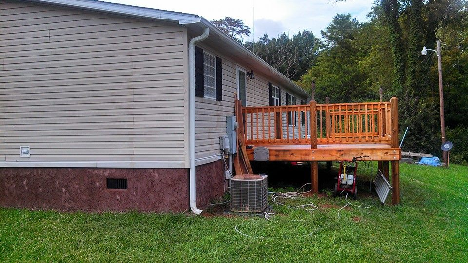 Back Of the Mobile Home With A New Back Deck Built.