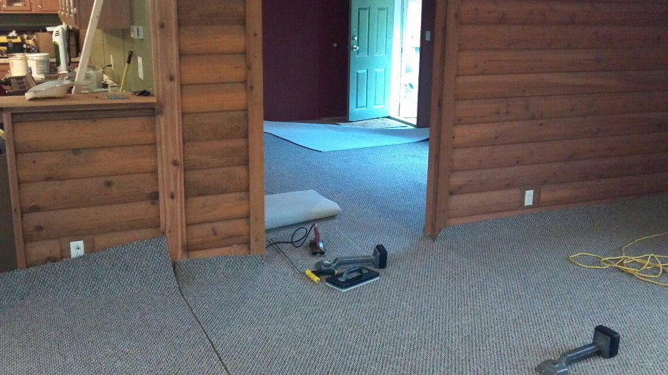 Putting Down New Carpet In  The Mobile Home.