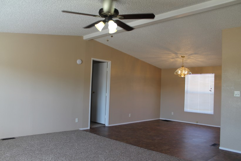 Large open Room With New Carpet And Tiling And Painted And Repaired Walls.