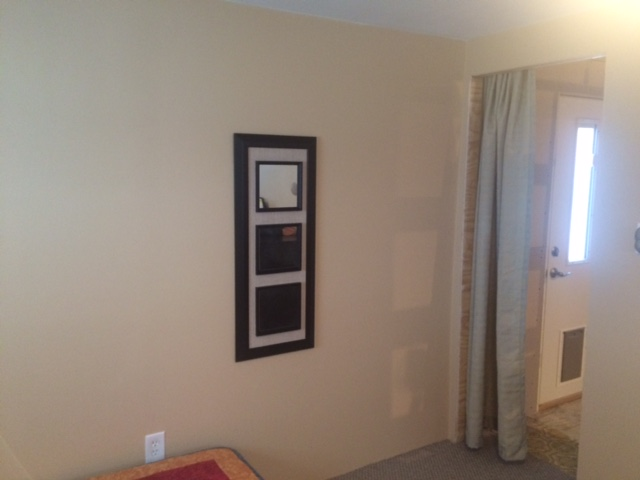Updated Master Bedroom Wall Painted White And New Carpeting.