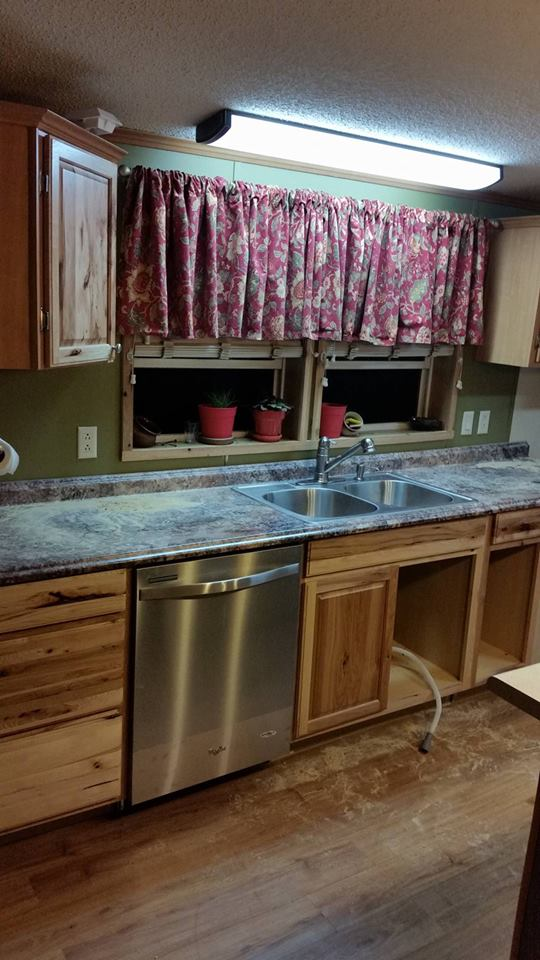 Kitchen With New Wood Cabinets, Stone Countertop And Stainless Steel Appliances.