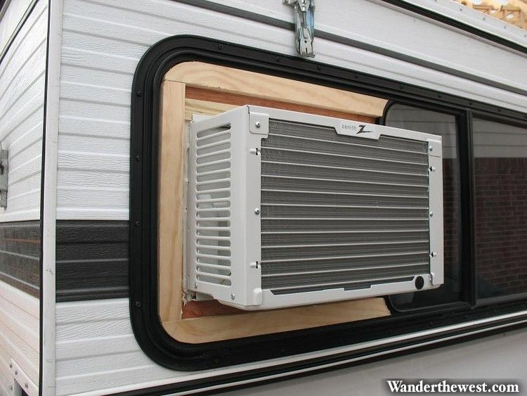 Side Of An RV With A Window Air Conditioner Installed.