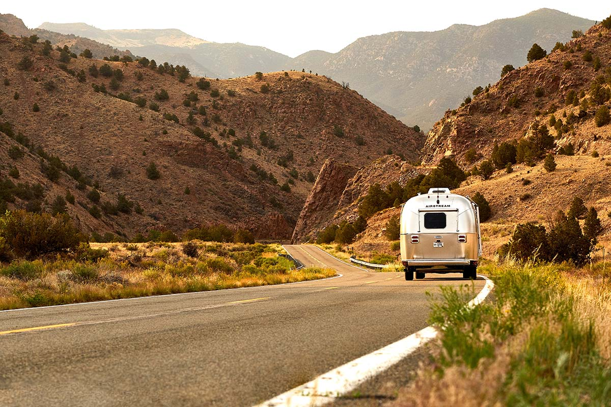 Air Stream RV Driving Through The Desert.