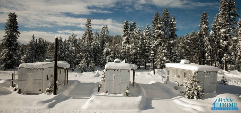 Three mobile homes in a snowy landscape