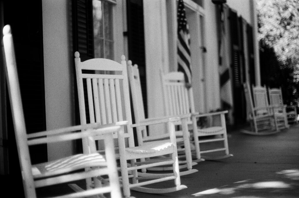 Black and white porch with white rocking chairs