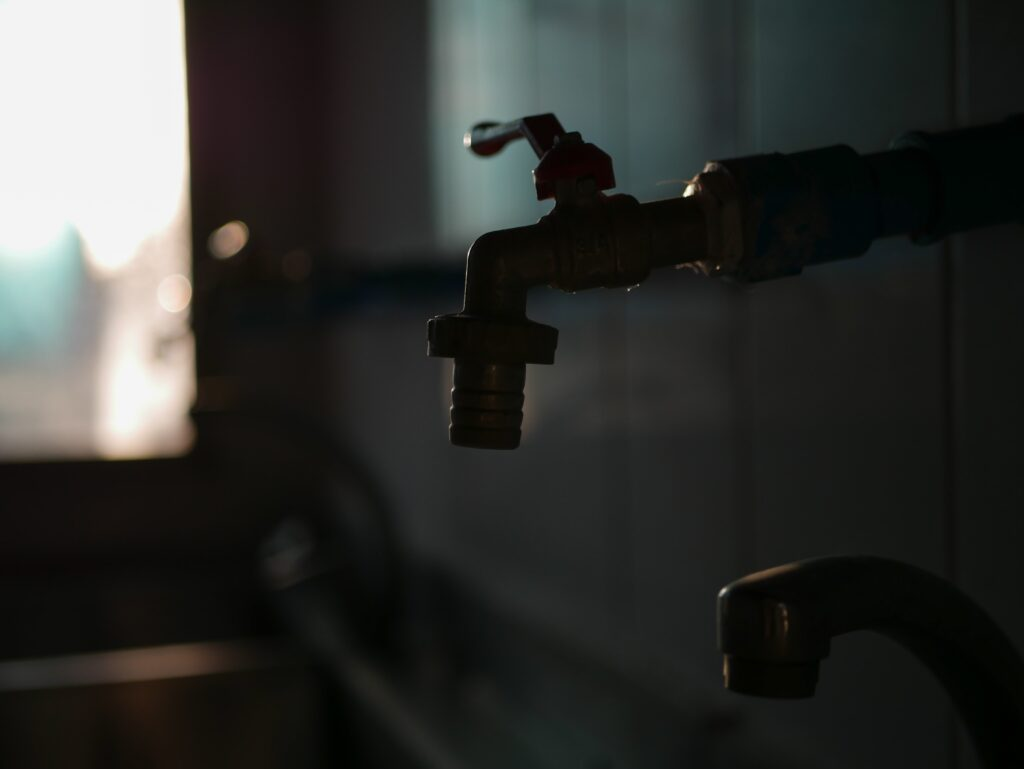 Dimly lit outline of water tap