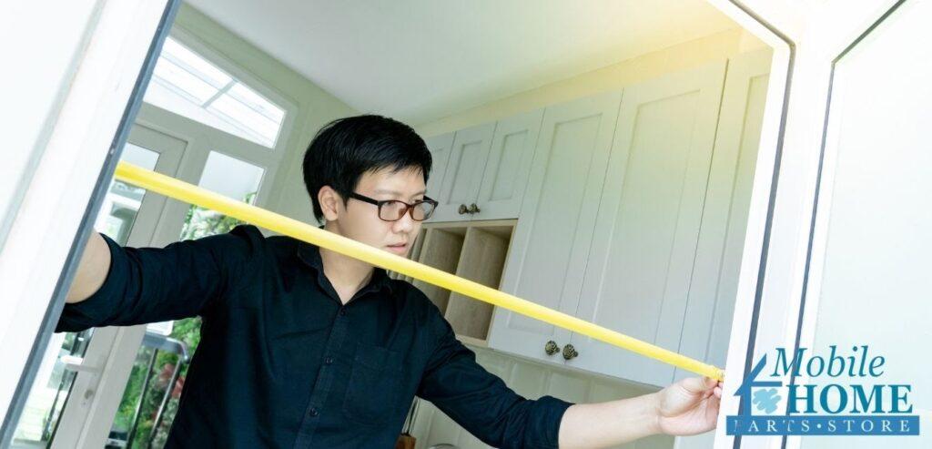 Man Measuring Mobile Home Door