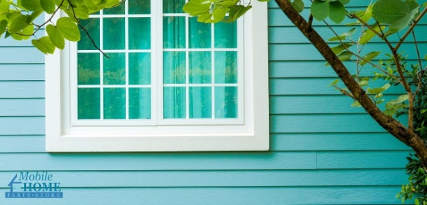 Outside view of windows on a teal mobile home