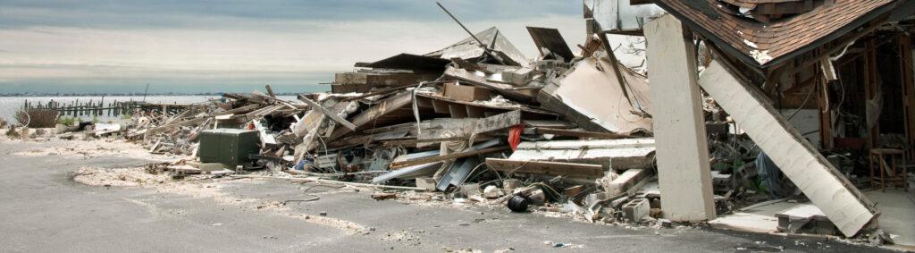 A home after a hurricane next to a beach dock