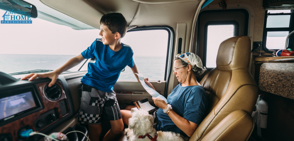 A mom looking at a map, and her son in a RV