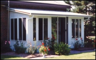 Enclosed Three Season Sun Room With Large Windows On All Sides